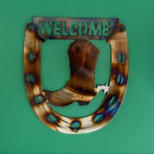 Welcome sign above brown boot surrounded by horseshoe